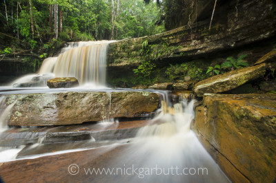 Giluk Falls, Maliau Basin, Borneo. A small aperture (f/22) and polarising filter were used here to reduce the shutter speed to 6 seconds, allowing the flowing water to register as abstract blur. The polariser also helps cut out glare and reflections and saturate the colours.